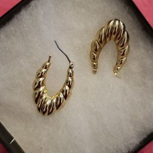 Gold hollow filled hoop earrings.  New in gift box